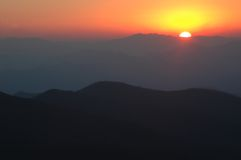Red sunset over smoky mountains Royalty Free Stock Photography