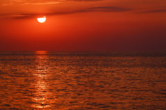 Red sunset over water Stock Photography