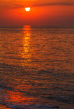 Red sunset over water Stock Photos
