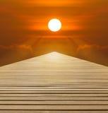 Red sunset over  wood walkway Stock Image
