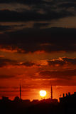 Red sunset scene with mosque and minarets Royalty Free Stock Images