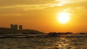 Red Sunset on the Sea with Boats Swaying on the Waves. Thailand. Pattaya. Beautiful landscape of the tourist seashore with yachts, motor boats, ships and other stock video footage