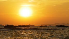 Red Sunset on the Sea with Boats Swaying on the Waves. Thailand. Pattaya. Beautiful landscape of the tourist seashore with yachts, motor boats, ships and other stock video