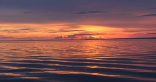 Red sunset on the sea. Dramatic red sunset on the sea stock footage