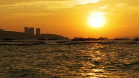 Red Sunset on the sea with silhouette boats swaying on the waves. Thailand. Pattaya. Beautiful landscape of the tourist seashore with yachts, motor boats stock video