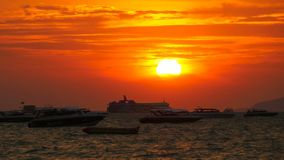 Red Sunset on the sea with Silhouette Boats Swaying on the Waves. Timelapse. Thailand. Pattaya. Red Sunset on the sea with silhouette boats swaying on the waves stock video footage