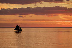 Red sunset and silhouette of old boat. Sunset or sunrise and boat Stock Photo