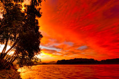 Red sunset sky over the river Katun. Altai Royalty Free Stock Photo