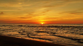 Sunset and orange sky. Sunset and red orange sky over sea stock photos