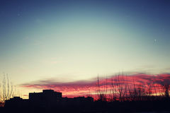 Red sunset sky silhouettes of buildings Stock Photo