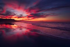 Red sunset in Sopelana beach. With reflections stock photography