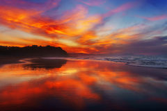 Red sunset in Sopelana beach. With reflections royalty free stock photography