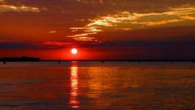 Red sunset in the Venetian lagoon, Italy Stock Photos