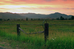 Red sunset in the Wasatch Mountains. Red sunset clouds above farm fields, Utah, USA Royalty Free Stock Photography