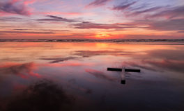 Red Sunset Wet Beach Cross Royalty Free Stock Photography