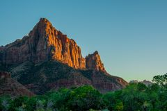 Red Sunset in Zion National Park green and orange colours with blue sky royalty free stock photography