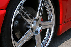 Red supercar chrome alloy tire. Front of red supercar chrome alloy tire Royalty Free Stock Photos