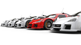 Red supercar standing out in a row of great white cars Royalty Free Stock Images