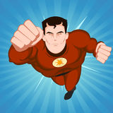Red Superhero. Illustration of a flying comic superhero character with red disguise on a blue beams background Royalty Free Stock Photo