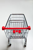 Red supermarket shopping cart on white Royalty Free Stock Image