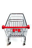 Red supermarket shopping cart on white Royalty Free Stock Photography
