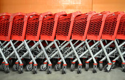 Red Supermarket Trolleys. Row of Supermarket Trolleys Stock Photography