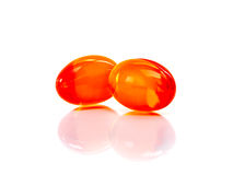 Red supplement capsules isolated on white background Stock Photos