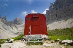 Red Supply Shed On A Mountain Trail Royalty Free Stock Images