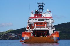 Supply vessel at the anchorage waiting for next contract within Oil and Gas industry. stock images