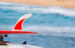 Red surfboard on a car Stock Images