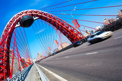 Red suspended bridge construction in Moscow Stock Image