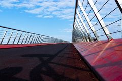 Red suspension bridge with a blue sky royalty free stock photo