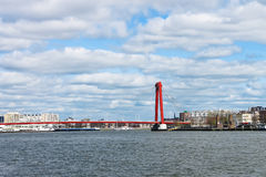 Red suspension bridge over  Maas in Rotterdam. Stock Photos