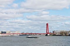 Red suspension bridge over  Maas in Rotterdam. Royalty Free Stock Photos