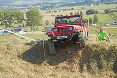 Red SUV at difficult terrain Royalty Free Stock Images