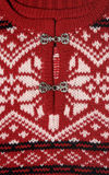 Red Sweater Detail. Detail of a red Norwegian sweater with two metal clasps Stock Image