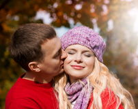 Red sweater, lilac hat, close up, smile, kiss Royalty Free Stock Photos