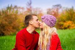 Red sweater, lilac hat, close up, smile, kiss Stock Photos