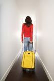 Red sweater woman with yellow suitcase Royalty Free Stock Photography