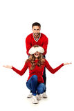 Red sweaters Stock Images