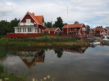 Red Swedish houses on the bay royalty free stock photo
