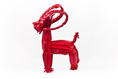Red Swedish straw Yule Goat on a white background Royalty Free Stock Photo