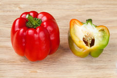 Red sweet bell peppers on a wooden background Stock Image