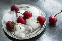 Red sweet cherries with ice cubes Royalty Free Stock Image