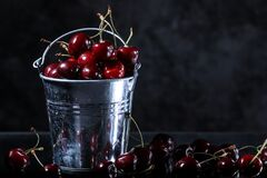 Free Red Sweet Cherries In A Metal Bucket On Black Background. Summer Taste. Fresh Berries Stock Images - 189133974