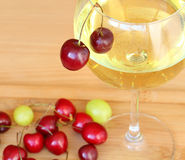 Red Sweet Cherries and white dry wine Stock Photography