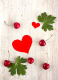 Red sweet cherry and hearts Royalty Free Stock Image