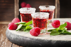 Red sweet cocktail with rapsberry and mint Stock Image