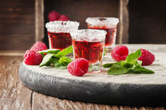 Red sweet cocktail with rapsberry and mint Stock Images