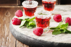 Red sweet cocktail with rapsberry and mint Royalty Free Stock Photos